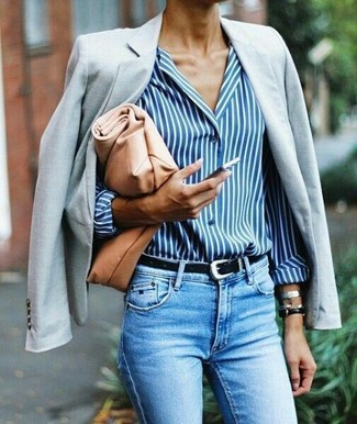 How to wear: grey blazer, white and blue vertical striped dress shirt, light blue skinny jeans, tan leather clutch