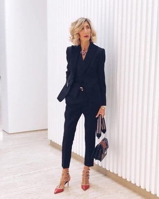 How to wear: black blazer, black dress shirt, black skinny pants, red studded leather pumps