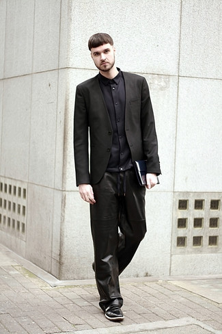 How to Wear Black Sweatpants For Men: If you're on the lookout for a relaxed casual and at the same time seriously stylish outfit, marry a black blazer with black sweatpants. Our favorite of a countless number of ways to finish this look is black leather double monks.