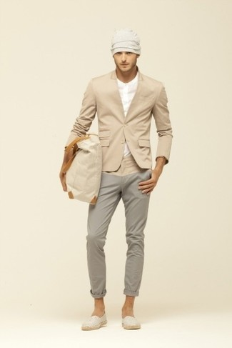 Opt for a camel blazer and grey chinos to look classy but not particularly formal. Dress down this getup with espadrilles.