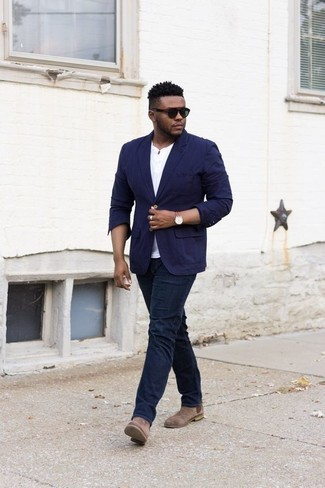 How to Wear a White Henley Shirt For Men: A white henley shirt and navy jeans are the kind of a winning casual look that you need when you have no time. Introduce brown suede chelsea boots to the equation to make the outfit slightly more sophisticated.