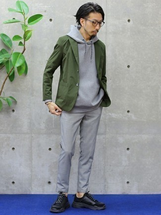 Grey Hoodie Outfits For Men: You'll be surprised at how easy it is for any gent to get dressed this way. Just a grey hoodie and grey chinos. A pair of black athletic shoes immediately revs up the street cred of your getup.