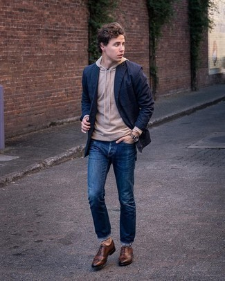 Dark Brown Leather Brogues Outfits: Reach for a navy blazer and navy jeans for a proper refined getup. You could perhaps get a little creative in the shoe department and add a pair of dark brown leather brogues.