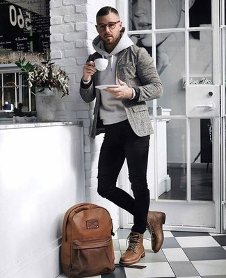 How to wear: grey plaid wool blazer, grey hoodie, black ripped skinny jeans, brown leather casual boots