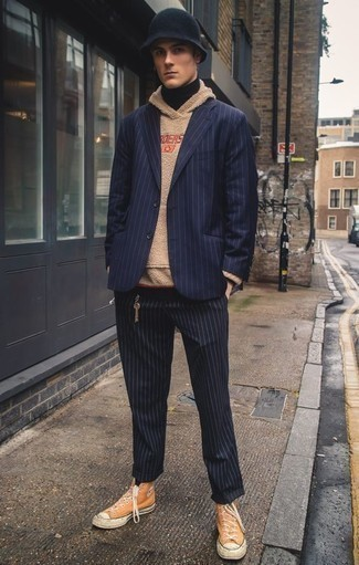 How to Wear a Navy Vertical Striped Blazer For Men: A pulled together combo of a navy vertical striped blazer and navy vertical striped chinos will set you apart instantly. Complete this ensemble with a pair of orange canvas high top sneakers to bring a hint of stylish casualness to this look.