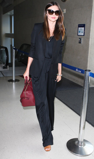 Miranda Kerr wearing Black Blazer, Black Jumpsuit, Tan Leather Heeled Sandals, Burgundy Leather Tote Bag