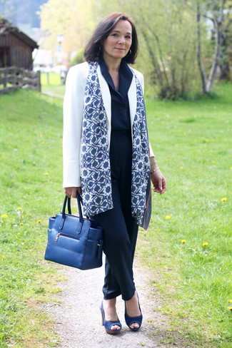 How to wear: white blazer, navy jumpsuit, navy canvas heeled sandals, navy leather tote bag