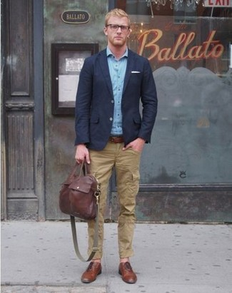 A blue long sleeve shirt and tan cargo pants are great staples that will integrate perfectly within your current looks. Round off this look with brown leather brogues.
