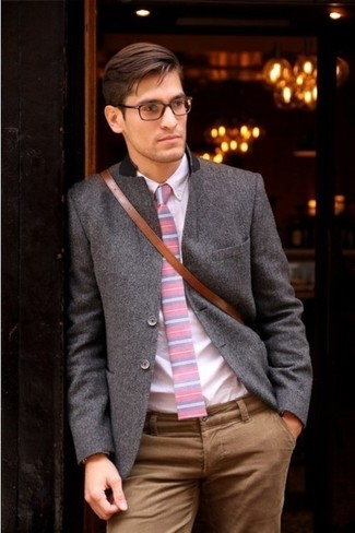 A dark grey wool sportcoat looks especially elegant when paired with tan chino pants. This one will play especially nice when spring arrives.