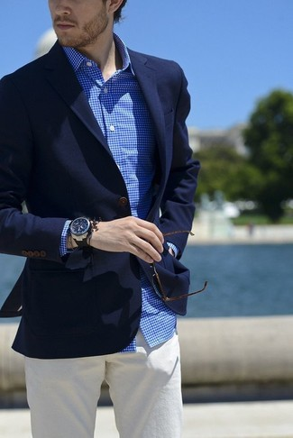 How to wear: navy blazer, blue gingham long sleeve shirt, beige chinos, dark brown sunglasses