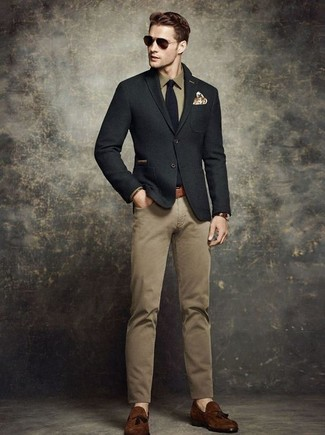 Reach for a black wool suit jacket and khaki chino pants for a dapper casual get-up. Go for a pair of dark brown suede tassel loafers for a masculine aesthetic.