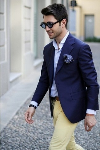 This combination of a blue button-down shirt and yellow chinos is perfect for a night out or smart-casual occasions.