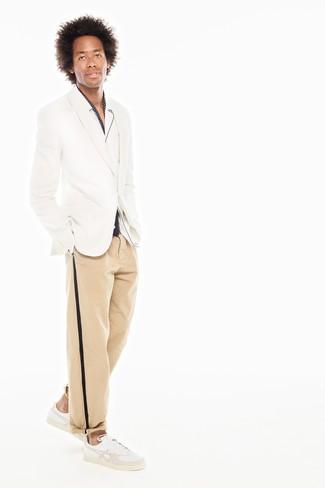 How to wear: white blazer, white long sleeve shirt, khaki chinos, white leather low top sneakers