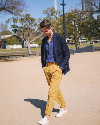 How to wear: navy blazer, navy chambray long sleeve shirt, yellow chinos, white leather low top sneakers