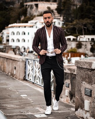 How to wear: black vertical striped blazer, white long sleeve shirt, black chinos, white leather low top sneakers