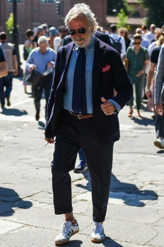 How to Wear a Belt After 60 For Men: Opt for a navy blazer and a belt if you're looking for an outfit option that is all about relaxed style. Rounding off with a pair of white and navy leather low top sneakers is a surefire way to bring a little zing to this look.