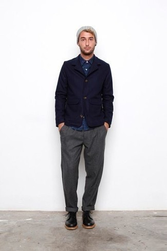 How to Wear a Navy Chambray Long Sleeve Shirt For Men: For an ensemble that's pared-down but can be styled in a variety of different ways, go for a navy chambray long sleeve shirt and grey chinos. Ramp up this whole ensemble by finishing with black leather derby shoes.