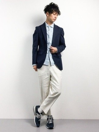 How to Wear a Navy Blazer For Men: If the setting calls for a sophisticated yet knockout look, reach for a navy blazer and white chinos. And if you want to easily dress down your look with one single piece, why not complement your look with navy athletic shoes?