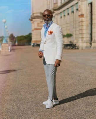 500+ Outfits For Men After 50: Wear a white blazer and grey chinos if you're going for a proper, sharp ensemble. For times when this ensemble appears all-too-fancy, tone it down with a pair of white and black canvas low top sneakers. And if we're talking outfit ideas for 50-year-old men, this ensemble looks nice on almost anyone.