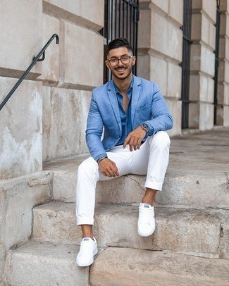 Light Blue Blazer Outfits For Men: Go for a straightforward yet sharp choice by wearing a light blue blazer and white chinos. A pair of white canvas low top sneakers introduces just the right amount of stylish casualness to this outfit.