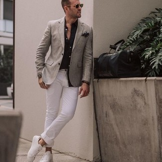 Black Long Sleeve Shirt Outfits For Men: Try pairing a black long sleeve shirt with white chinos for both on-trend and easy-to-achieve ensemble. Don't know how to round off? Add a pair of white canvas low top sneakers to the mix for a more relaxed twist.