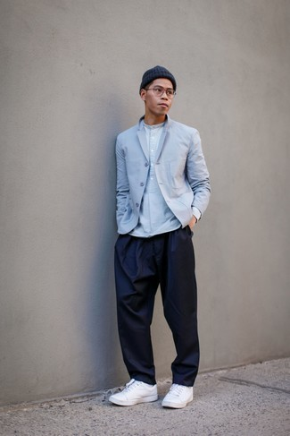 Light Blue Blazer Outfits For Men: Dress in a light blue blazer and navy chinos to assemble a neat and elegant menswear style. Introduce white leather low top sneakers to the equation to bring an air of stylish effortlessness to this ensemble.