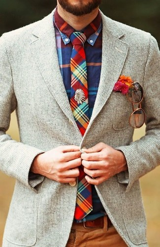 Try teaming a multi colored plaid long sleeve shirt with brown corduroy dress pants for a classic and refined silhouette. As the temps lower, you'll see that an outfit like this is great for fall.