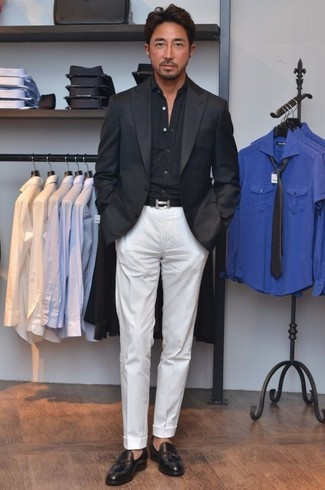 A black long sleeve shirt and white dress pants are great essentials to incorporate into your current wardrobe. A pair of black leather tassel loafers fits right in here. This combination isn't a hard one to achieve and it's summer-friendly, which is important when it's blazing hot outside.