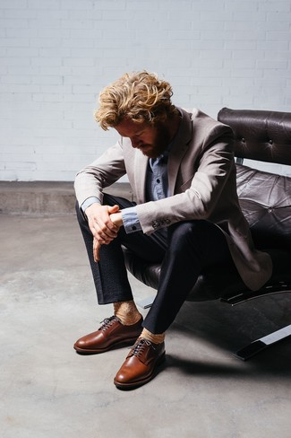 How to Wear a Grey Blazer For Men: A grey blazer and black seersucker dress pants are a classy look that every modern gent should have in his closet. Introduce a pair of brown leather derby shoes to the mix and you're all set looking awesome.