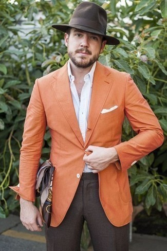 How to Wear a White Pocket Square: One of the coolest ways for a man to style out an orange blazer is to team it with a white pocket square in a casual ensemble.