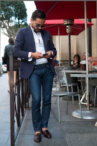 Pair a deep blue sport coat with dark blue jeans to achieve a dressy but not too dressy look. Dark red leather loafers complement this look very well. This one will play especially well when summer settles in.