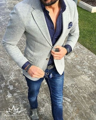 A grey knit blazer and navy jeans are a nice combination that will earn you the proper amount of attention. Dress up your getup with grey leather double monks.