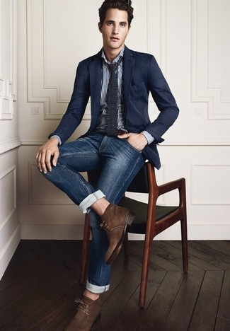Something as simple as teaming a navy blazer with deep blue jeans can potentially set you apart from the crowd. Tap into some David Gandy dapperness and complete your look with dark brown suede chukka boots.