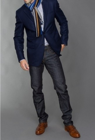 A smart casual combination of a dark blue sportcoat and dark grey jeans can maintain its relevance in many different circumstances. A pair of brown leather brogues will seamlessly integrate within a variety of outfits.
