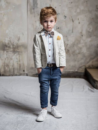 How to Wear Navy Jeans For Boys: For an everyday outfit that is full of character and personality reach for a grey blazer and navy jeans for your boy. White sneakers are a smart choice to round off this getup.