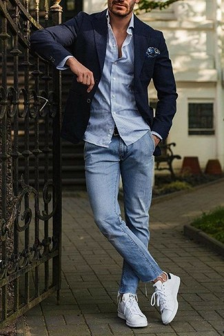 How to wear: navy blazer, light blue vertical striped long sleeve shirt, light blue jeans, white leather low top sneakers