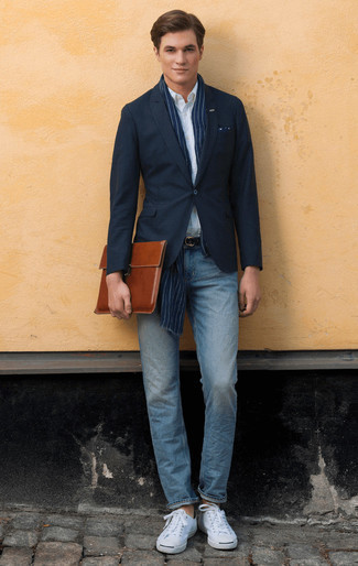 How to Wear Light Blue Jeans For Men: A navy blazer and light blue jeans will add classy style to your daily rotation. Finish with white canvas low top sneakers to transform your outfit.