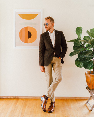 How to Wear Khaki Jeans For Men: You can look cool and casual without really trying by opting for a dark brown check wool blazer and khaki jeans. Make your look slightly more polished by finishing off with a pair of brown leather derby shoes.