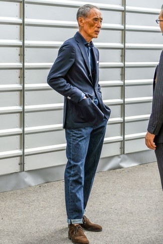 Fashion for Men Over 60: What To Wear: Go for a simple yet polished option by opting for a navy blazer and navy jeans. If in doubt as to what to wear in the shoe department, stick to a pair of dark brown suede desert boots.