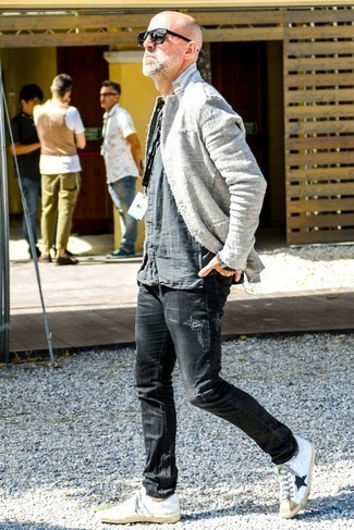 How to Wear White and Black Leather Low Top Sneakers For Men: You'll be surprised at how easy it is for any gentleman to get dressed this way. Just a grey linen blazer teamed with black ripped jeans. Add white and black leather low top sneakers to the equation and the whole outfit will come together perfectly.