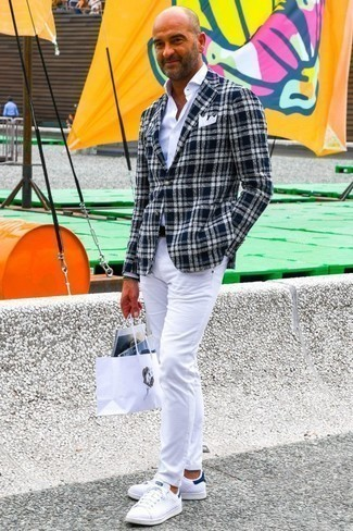 How to Wear White Jeans For Men: This casual combination of a navy and white plaid blazer and white jeans comes to rescue when you need to look cool in a flash. With footwear, go for something on the laid-back end of the spectrum by sporting a pair of white and navy low top sneakers.