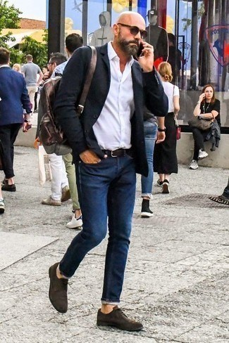 How to Wear Navy Jeans For Men: This pairing of a black blazer and navy jeans is the perfect base for a multitude of effortlessly classic combinations. A great pair of dark brown suede derby shoes is a simple way to add a confident kick to the look.
