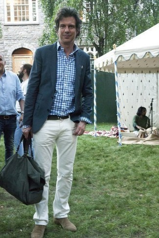 Fashion for Men Over 40: What To Wear: If the dress code calls for a casually sleek ensemble, wear a navy blazer and white jeans. Clueless about how to complement your look? Rock beige suede chelsea boots to class it up. Like this idea for your styling arsenal as a gent in his 40s?