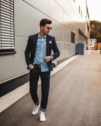 White and Blue Vertical Striped Long Sleeve Shirt Outfits For Men: Effortlessly blurring the line between sharp and casual, this combo of a white and blue vertical striped long sleeve shirt and black jeans will easily become your go-to. White and black canvas low top sneakers integrate smoothly within a myriad of looks.