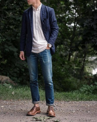 Navy Blazer Outfits For Men: A navy blazer and navy ripped jeans will infuse extra style into your current off-duty rotation. Finishing with brown leather derby shoes is the most effective way to bring a hint of elegance to your look.