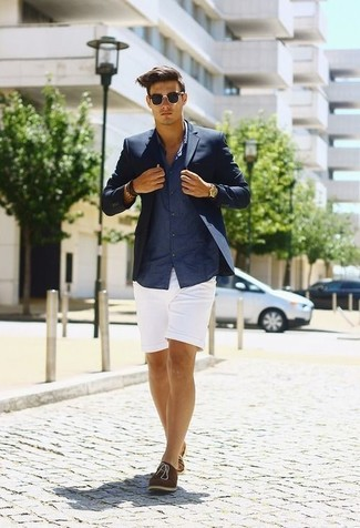 No matter where you go over the course of the day, you'll be stylishly prepared in a dark blue sport coat and white shorts. Dress up your ensemble with brown suede oxford shoes. You know when it's boiling hot outside, sometimes only a proper outfit like this one can get you through the day.
