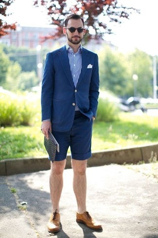 How to wear: blue cotton blazer, white and blue vertical striped long sleeve shirt, navy shorts, tan leather brogues