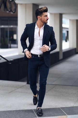 How to Wear Navy Skinny Jeans For Men: Consider teaming a navy blazer with navy skinny jeans if you seek to look laid-back and cool without too much work. Black leather loafers will give a hint of refinement to an otherwise mostly casual getup.