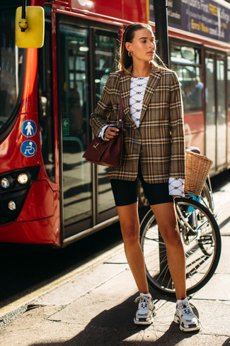 How to wear: brown plaid blazer, white print long sleeve t-shirt, black bike shorts, multi colored athletic shoes