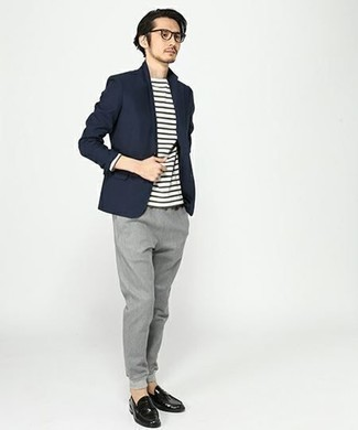 How to Wear a Navy Blazer For Men: A navy blazer and grey chinos worn together are a perfect match. Why not take a classic approach with shoes and opt for a pair of black leather loafers?